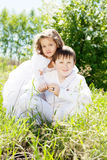 Brother and sister in a blossoming garden Stock Images