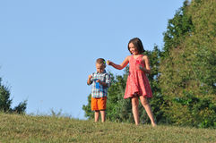 Brother and sister blowing bubbles Royalty Free Stock Image