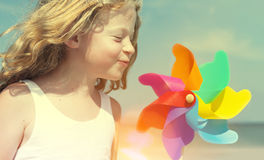 Brother Sister Blowing Windmill Beach Enjoyment Concept Stock Images