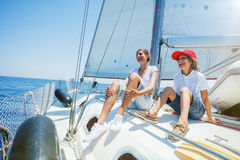 Brother and sister on board of sailing yacht on summer cruise. Travel adventure, yachting with child on family vacation. Royalty Free Stock Photography