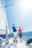 Brother and sister on board of sailing yacht on summer cruise. Travel adventure, yachting with child on family vacation. Royalty Free Stock Images