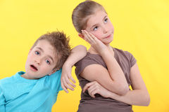 Brother and sister are bored. Royalty Free Stock Image