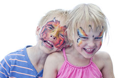 Brother and sister, boy and girl with faces painted isolated on