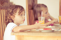 Brother and sister at breakfast Stock Photography