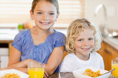 Brother and sister with breakfast in the kitchen Royalty Free Stock Photography