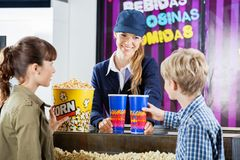 Brother And Sister Buying Popcorn From Seller In Stock Image