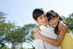 Brother and sister. Cheerful brother and sister smiling and looking at camera Stock Photo
