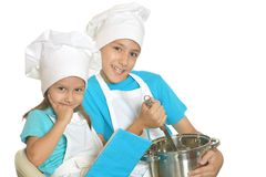 Brother and sister in chef uniforms Royalty Free Stock Photos