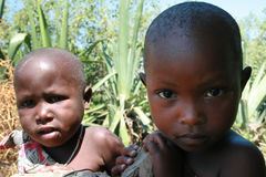 Brother and sister, children of the Maasai, close-up portrait. Royalty Free Stock Image