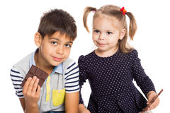 Brother and sister with chocolate Stock Photo