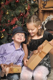 Brother and sister at the Christmas tree Royalty Free Stock Image