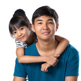 Brother & sister. Closeup happy young sister and brother, Isolated over white Stock Photo