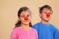 Brother and sister with clown noses Royalty Free Stock Image