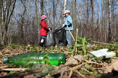 Brother and sister collect last year trash Stock Photography