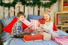 Brother and sister are considering Christmas presents Stock Image