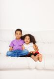 Brother and sister on the couch Royalty Free Stock Image