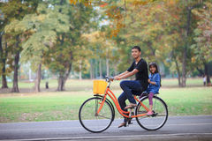 Brother and sister cycling bicycle at the park Stock Photos