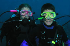 Brother and sister divers underwater royalty free stock photography