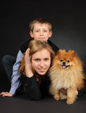 Brother and sister with a dog Royalty Free Stock Images