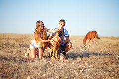 Brother and sister with dog Royalty Free Stock Photos