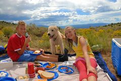Brother sister and dog on picnic. Brother and sister on picnic in the mountains Royalty Free Stock Photo