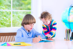 Brother and sister doing homework Stock Photography