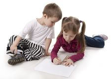 Brother and sister draws on a ruler Royalty Free Stock Images