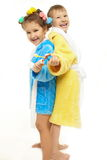 Brother and sister dressing gown brush their teeth Royalty Free Stock Image