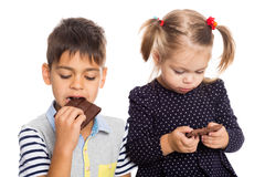 Brother and sister eating chocolate Royalty Free Stock Photo