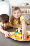 Brother and sister eating cookies Royalty Free Stock Photos