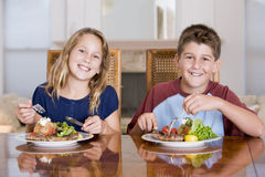 Brother And Sister Eating meal, mealtime Together Royalty Free Stock Photography