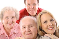 Brother & sister with elderly parents. Brother & sister with elderly parents isolated on white Stock Photos