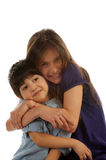 Brother and Sister. Embraces on white background Stock Images