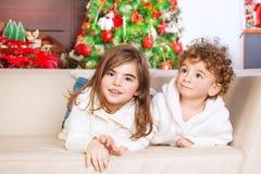 Brother and sister enjoying Christmas Royalty Free Stock Photos