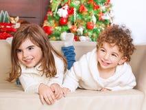 Brother and sister enjoying Christmas Stock Images