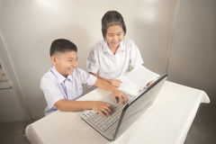 Brother and sister enjoying computer btime. Royalty Free Stock Photo