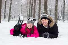 Brother and sister enjoying with his dog in the snow Royalty Free Stock Images