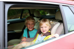 Brother and sister enjoying trip in the car Royalty Free Stock Photos