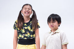 Brother sister. Family asian kids cute boy girl young happy fun joke funny giggle glad Royalty Free Stock Image