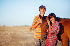 Brother and sister in a field Royalty Free Stock Photography