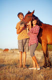 Brother and sister in a field Stock Image