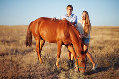 Brother and sister in a field Royalty Free Stock Photos