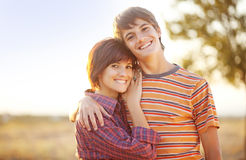 Brother and sister in a field Royalty Free Stock Image