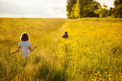 Brother and sister in a field stock photo