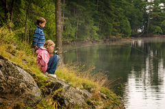 Brother and sister fishing Stock Photo
