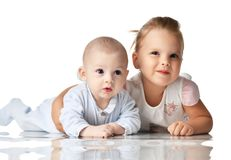 Brother and sister. Four month infant baby boy and two years old girl toddler kid lying together hugging happy smiling Stock Photography