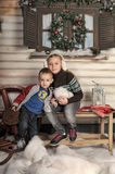 Brother and sister  in front of the house in winter Royalty Free Stock Photography