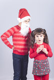 Brother and sister full of Christmas spirit Stock Images