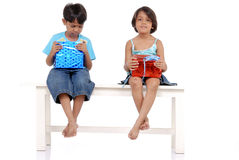 Brother and sister with gift boxes Royalty Free Stock Photo