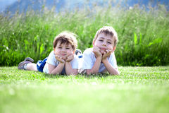 Brother and sister in grass Royalty Free Stock Images